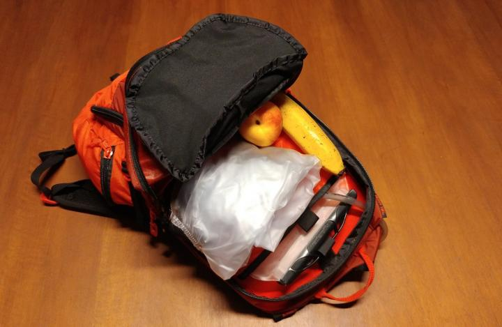 Backpack with food, water and rainsuit